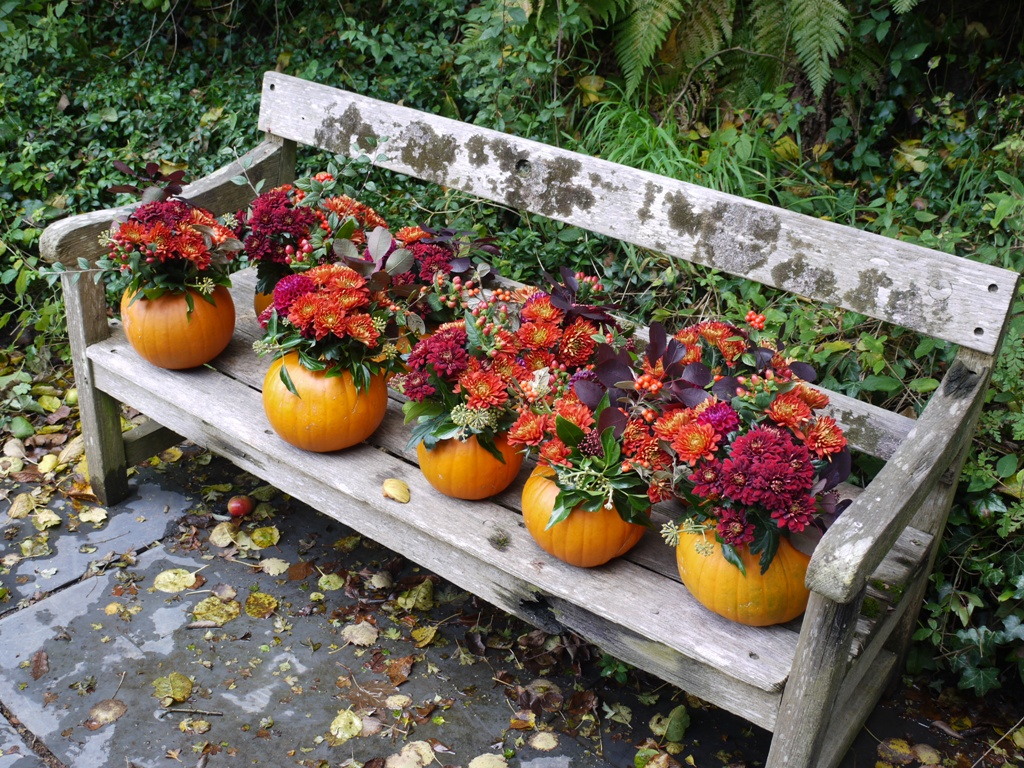 Pumpkin table centrepieces filled with flowers