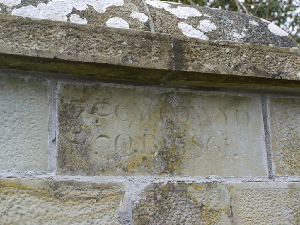 The left hand gatepost has the Welsh inscription