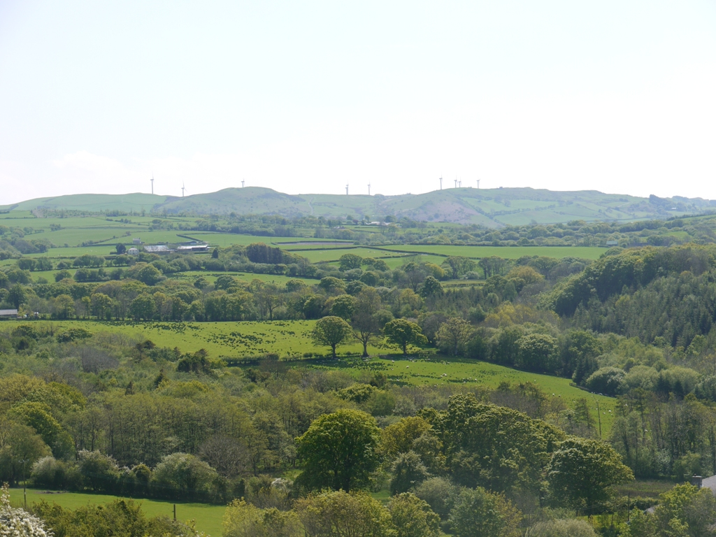 Wind turbines on the skyline of Mynydd Bach, six miles to the south
