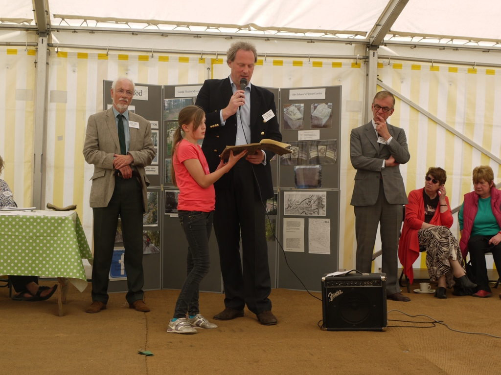 Giles Inglis Jones, assisted by his daughter, reads an extract from Richard Payne Knight's poem The Landscape a didactic poem (1794)  in praise of the Picturesque to the guests of the Hafod Trust.
