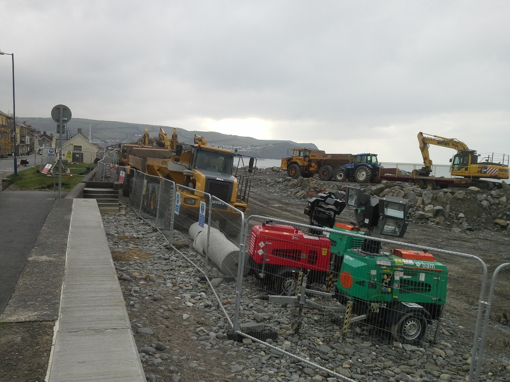 Diggers and dumper lorries at Borth.