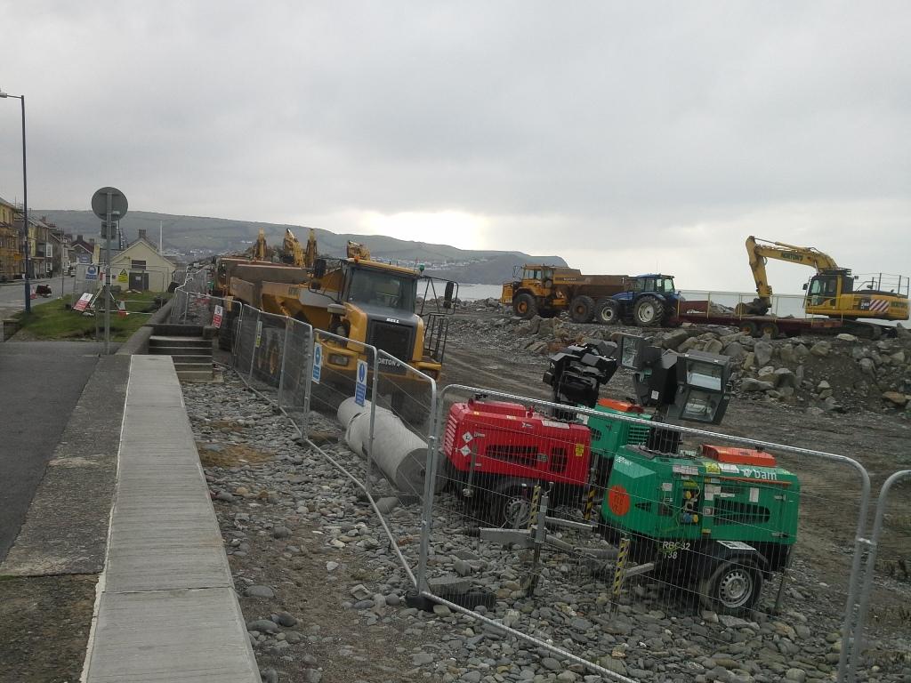 Diggers and dumper lorries at Borth.