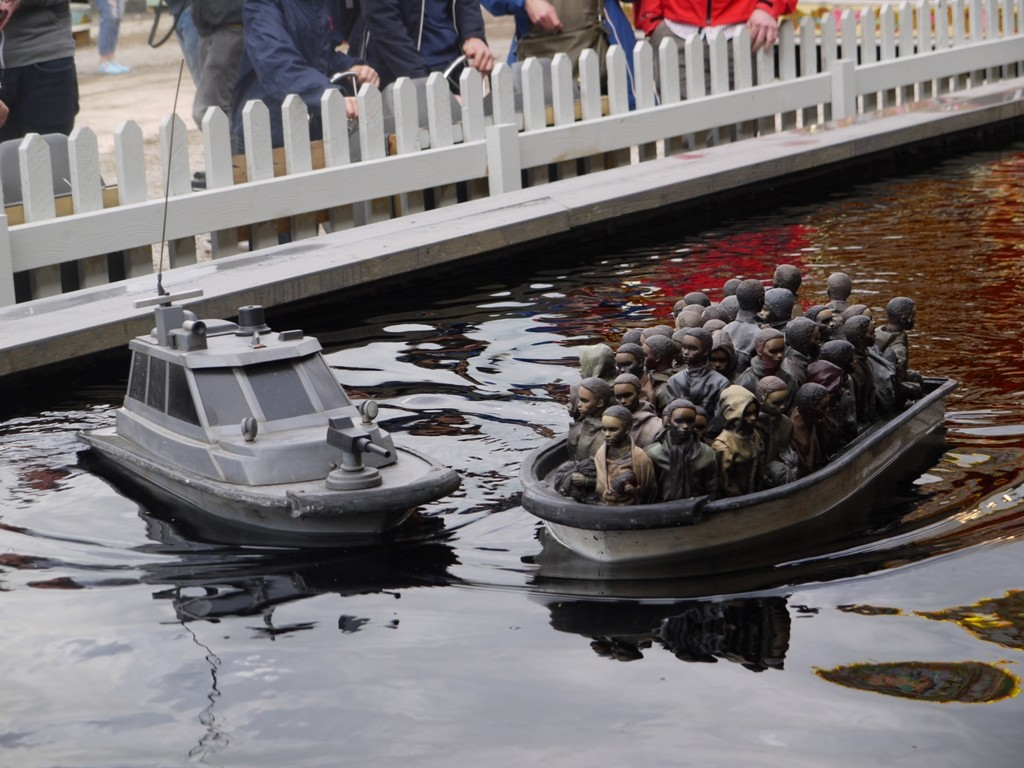 A Gunboat harries the huddled masses at Dismaland