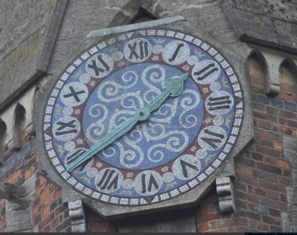 Clock face mosaic by Jesse Rust, at Ayot St Peter